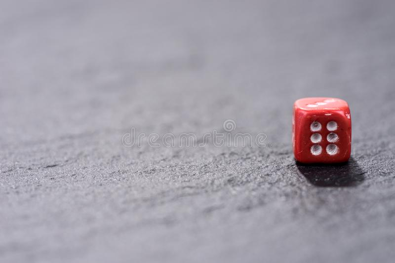 Single red dice on black background royalty free stock photography