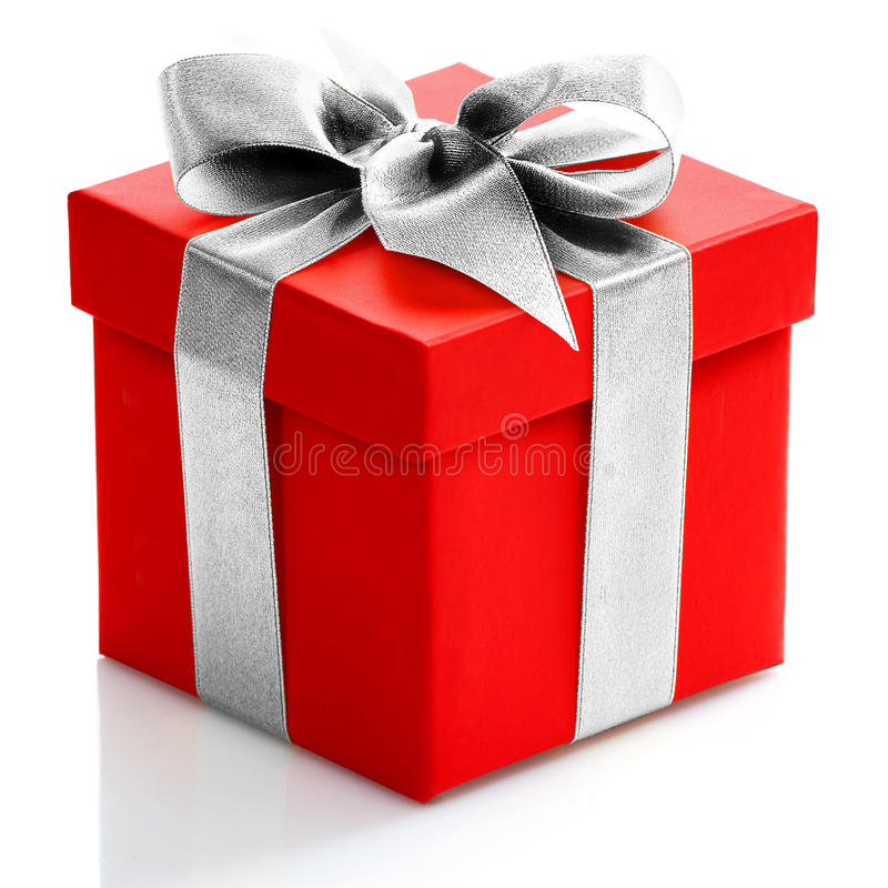 Single red gift box with gold ribbon on white background. royalty free stock image