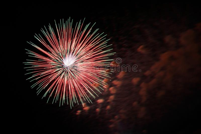 Single red and green party firework, celebration. Single red and green firework, abstract, teture, holiday background royalty free stock photography