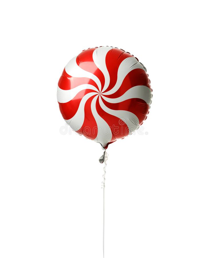 Single red spiral metallic candy lollipop balloon for birthday party. Isolated on a white background stock photo