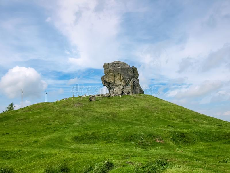 Single rock on hill in Pidkamin, Lviv Oblast, Ukraine. Single rock on hill on a background of sky at springtime. Geological monument of nature, Pidkamin, Lviv royalty free stock image