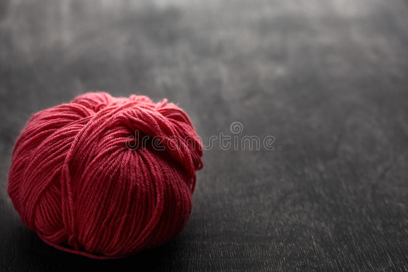 Single rose ball of yarn with soft focus. stock image