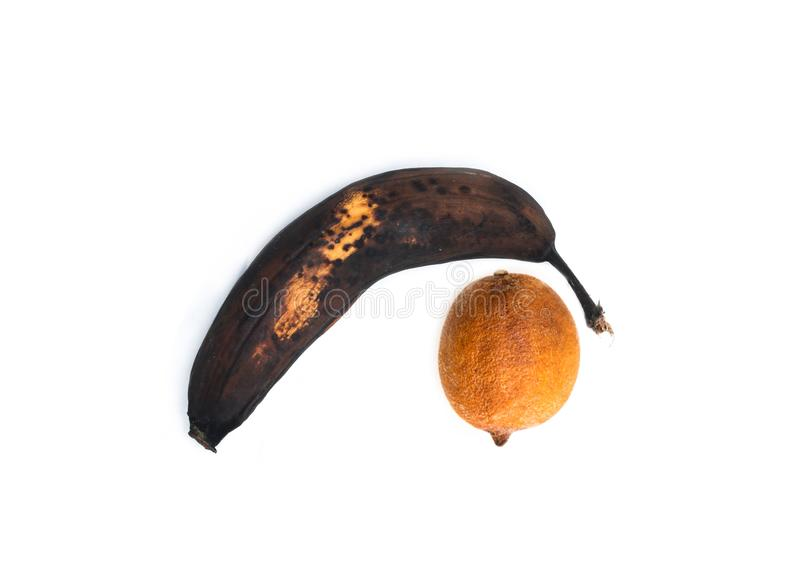 Single rotten banana with a dry lemon. A single rotten banana with a dry lemon as a symbol for elder man´s unhealthy genital. It can be disease or impotency stock photo