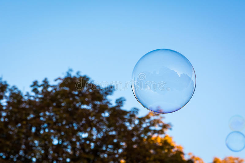 Single Round Circular Soap Bubble Blue Sky Nature Background Ora royalty free stock photography