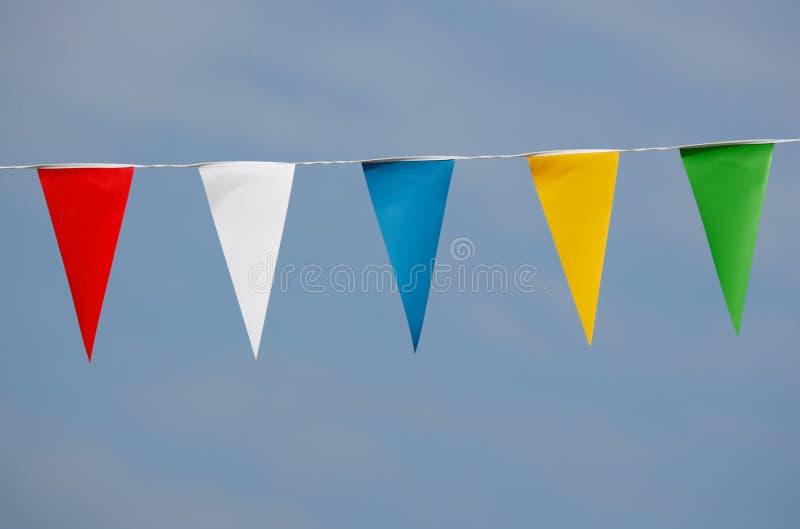Single row of triangle shaped pennants royalty free stock photo