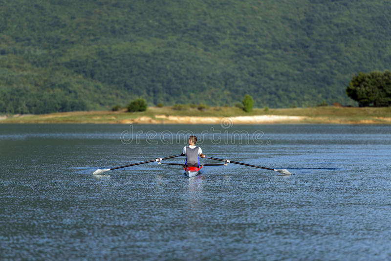 Single rower at sunrise. At the lake royalty free stock photography