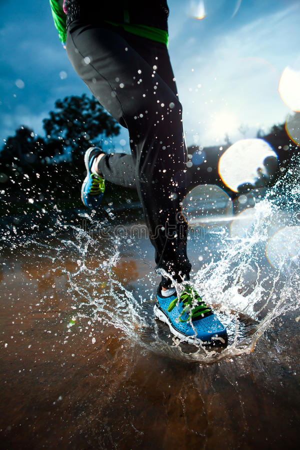 Single runner running in rain stock image