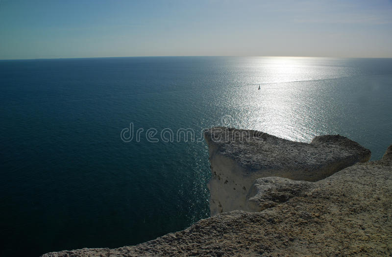 A single sail on the sea, South England, UK royalty free stock images