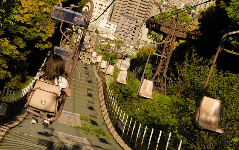Single Seat Chair Ropeway. A view of the single seat ropeway leading down and up from Matsuyama Castle in Matsuyama, Japan. Photo taken on: April, 2016 stock image