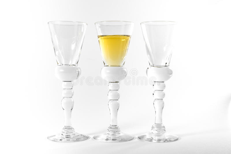 Single Shot Glass Wine Style Isolated White Background Triple Th. Ree Together Full Empty Contrast Elegant Fancy Round Stem royalty free stock photography