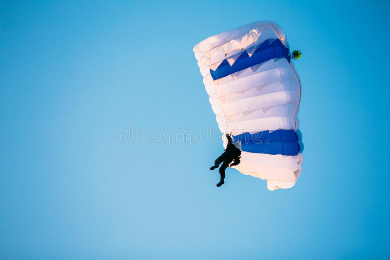 Single Skydiver On Parachute In Blue Clear Sky. Active Lifestyle stock photos