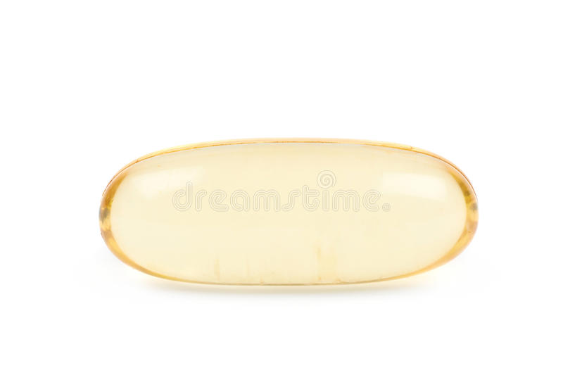 Single softgel pill isolated. Single yellow softgel pill isolated over the white background stock photos