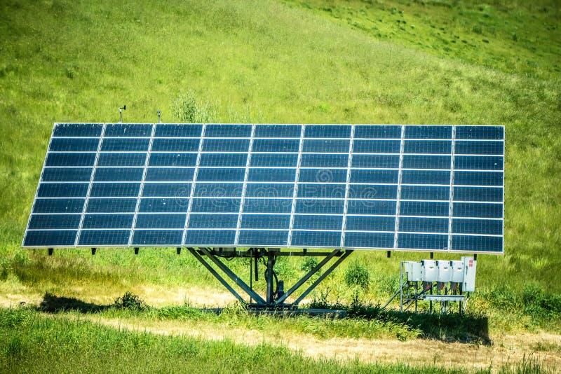 Single solar panel making energy on sunny day stock photography