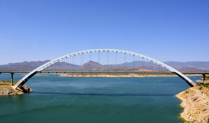 Single-span, steel-arch bridge. View of the Roosevelt Lake Bridge, Arizona, the longest two-lane single-span, steel-arch bridge in North America. The bridge was stock photography