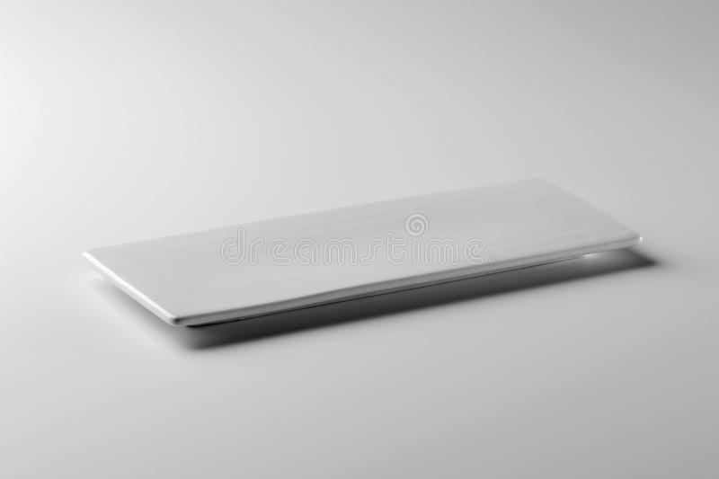 Single Square white plate on white table stock image