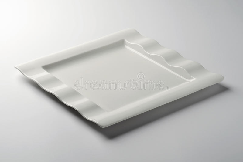 Single Square white plate on white table stock images