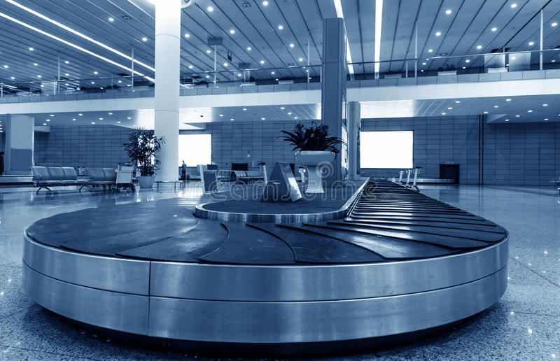 Single suitcase alone on airport royalty free stock photography