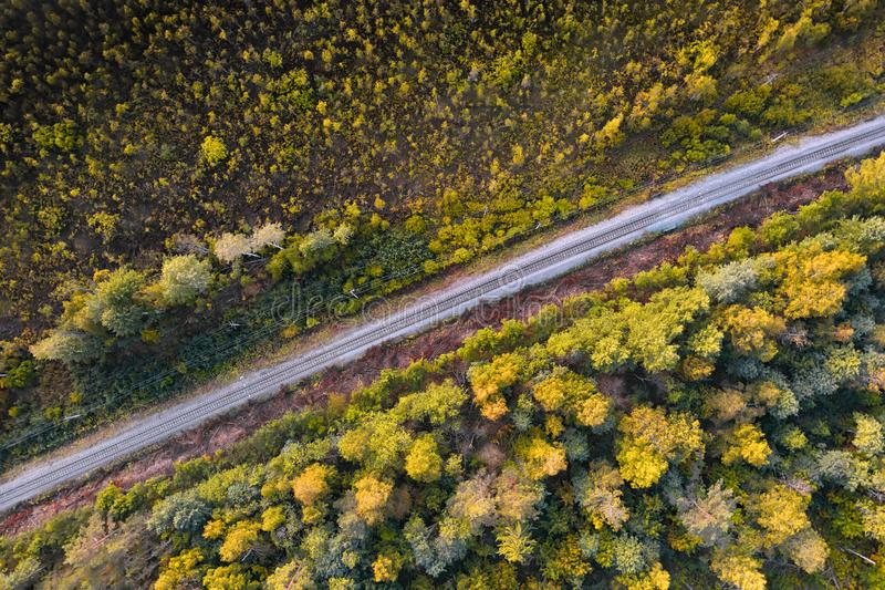 Single track railway through the forest aerial view. Single track railway through the deep forest top aerial view stock images