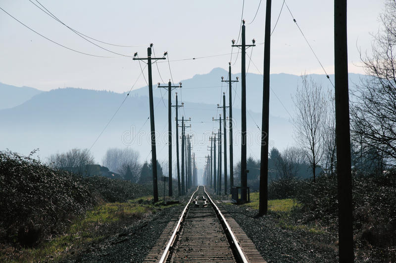 Single Track Through Rural Landscape. A single railway track extends through a rural landscape royalty free stock images