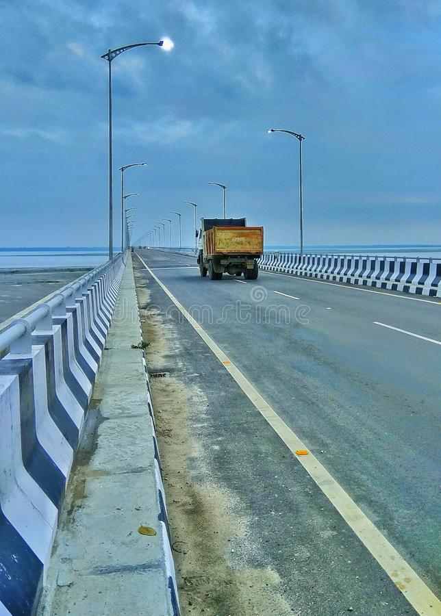 Bogibeel bridge in Assam, northeast, India. The Next level of the architecture. Single truck on Bogibeel bridge in Assam, northeast, India. The Next level of the royalty free stock photo