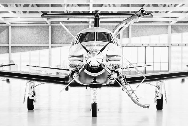 Single turboprop aircraft Pilatus PC-12 in hangar. Stans, Switzerland. 29th November 2010 royalty free stock image
