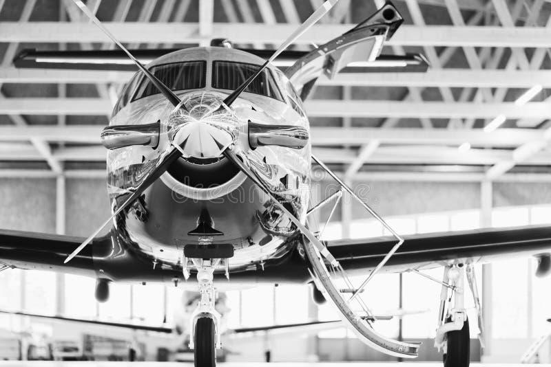 Single turboprop aircraft Pilatus PC-12 in hangar. Stans, Switzerland, 29th November 2010. Single turboprop aircraft Pilatus PC-12 in hangar. Stans, Switzerland stock image
