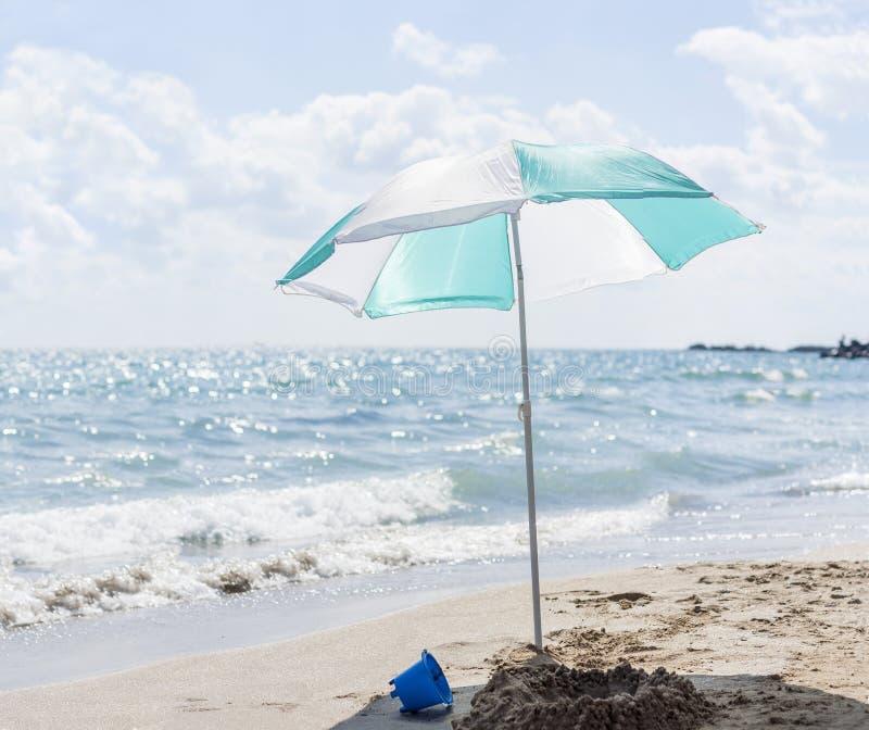 Single umbrella on the beach royalty free stock image