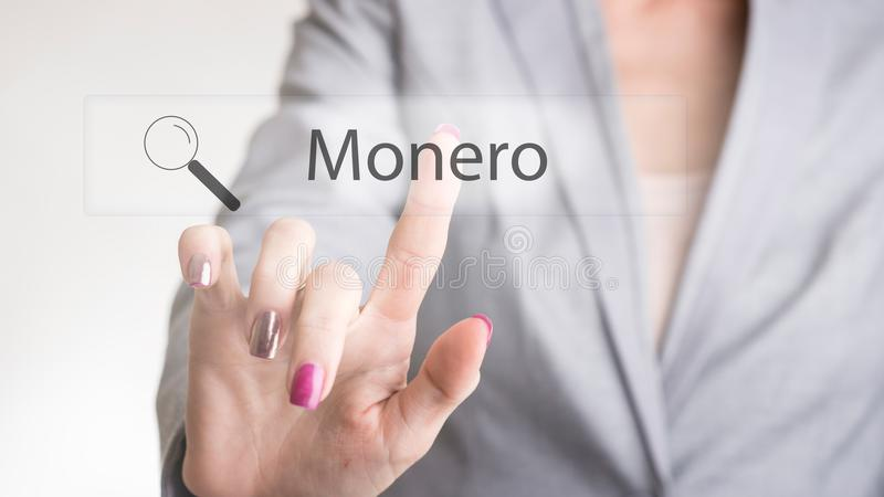 Single unidentifiable female business person typing Monero text royalty free stock image