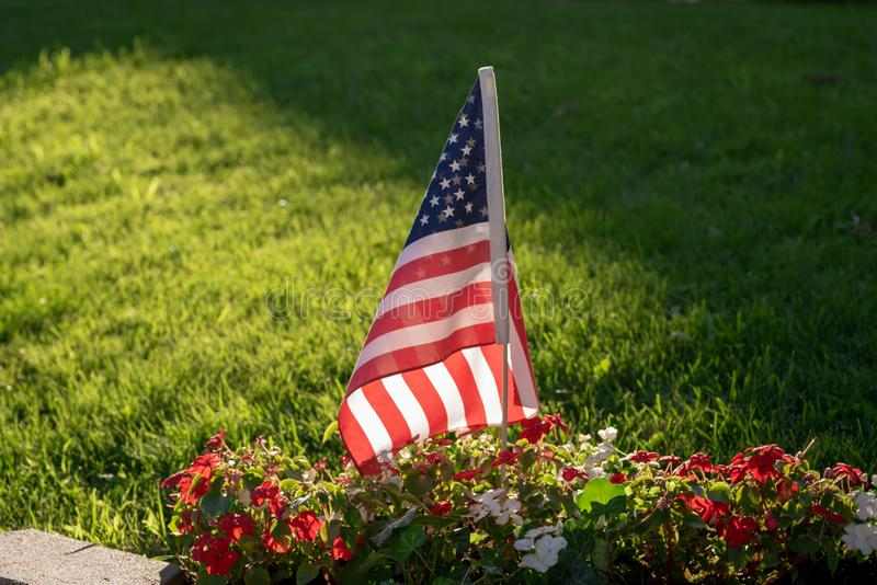 Single US flag in sunlight royalty free stock photos