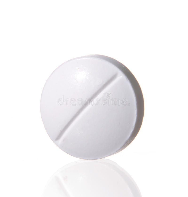 Single white pill. Macro shoot of single white pill isolated on white background. Close-up stock photography