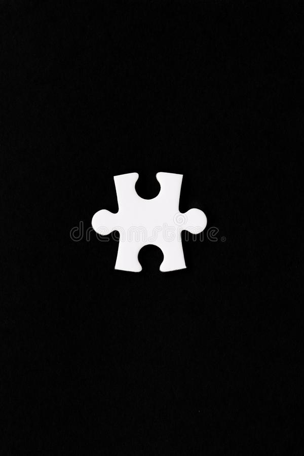 A single white puzzle piece stock images