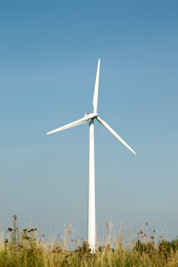 Single wind turbine with blue sky royalty free stock photos