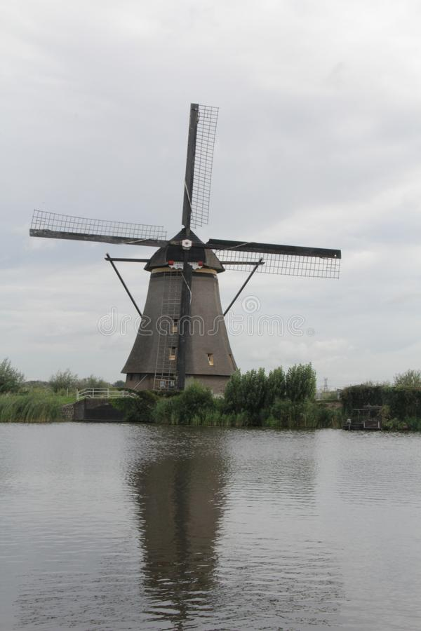 Single Windmill at Kinderdijk, Netherlands. One of nineteen windmills at Kinderdijk, Netherlands, a UNESCO World Heritage Site stock photography