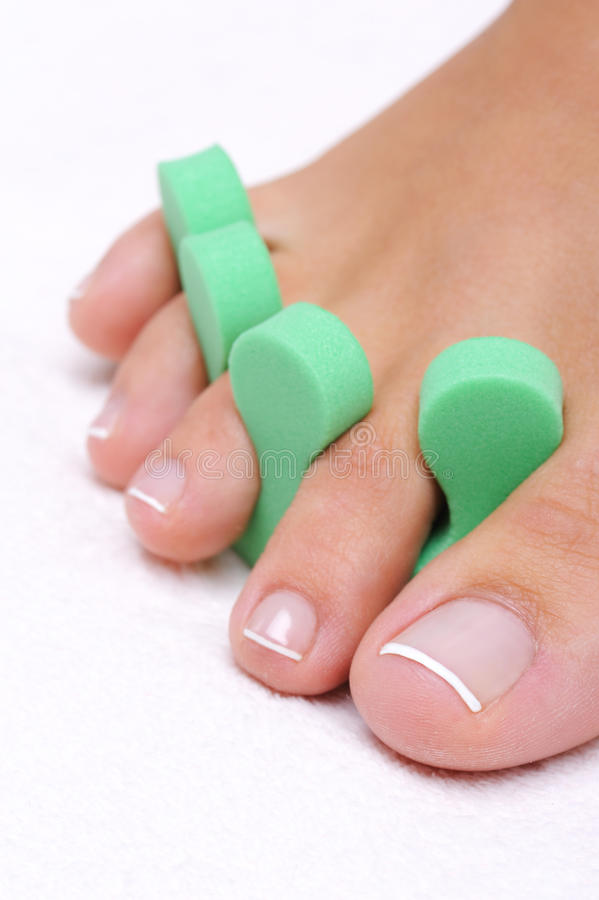 Single woman foot with pedicure tool stock photos