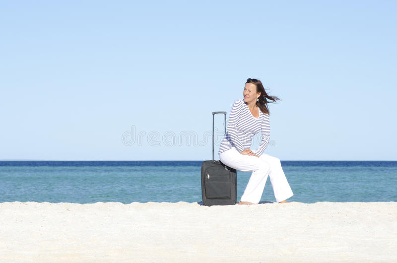 Download Single Woman Waiting With Luggage At Seaside Stock Image - Image: 26071009