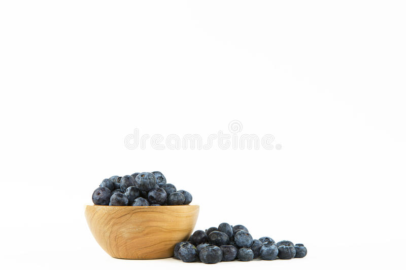 Single Wooden Bowl of Blueberries stock images