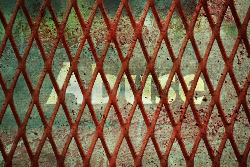 Single word Abuse. Written under rundown rusty fence stock photos