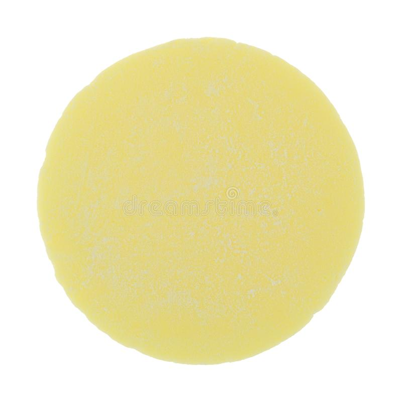 Single yellow candy wafer isolated on a white background royalty free stock image