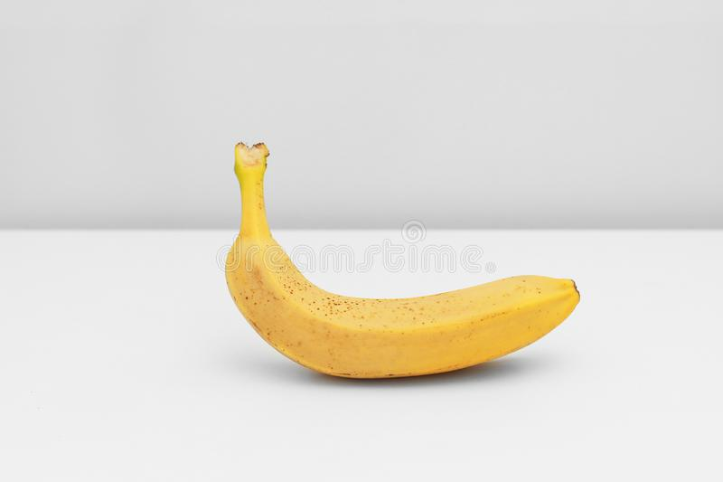 Single yellow ripe banana isolated on white background. Fiber fruits royalty free stock photography