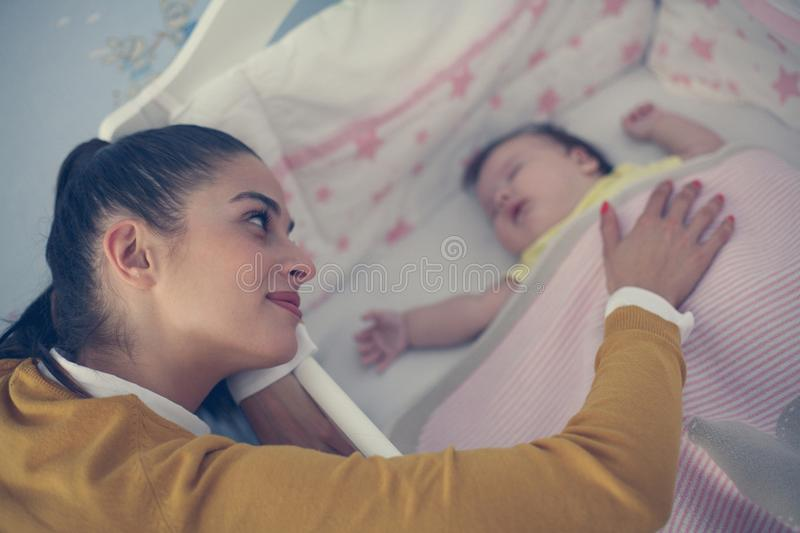 Young mother is sleeping her baby. Single Young mother is sleeping her baby stock image