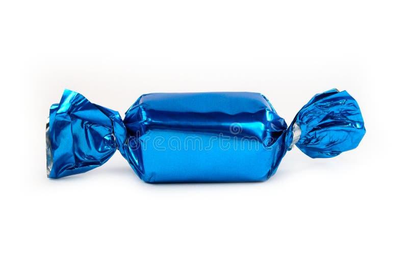 Singola caramella blu isolata immagine stock