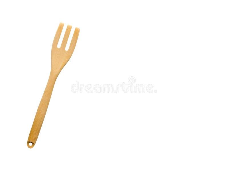 Singola forcella di legno isolata su fondo bianco forcella di legno dell'attrezzatura della cucina fotografia stock