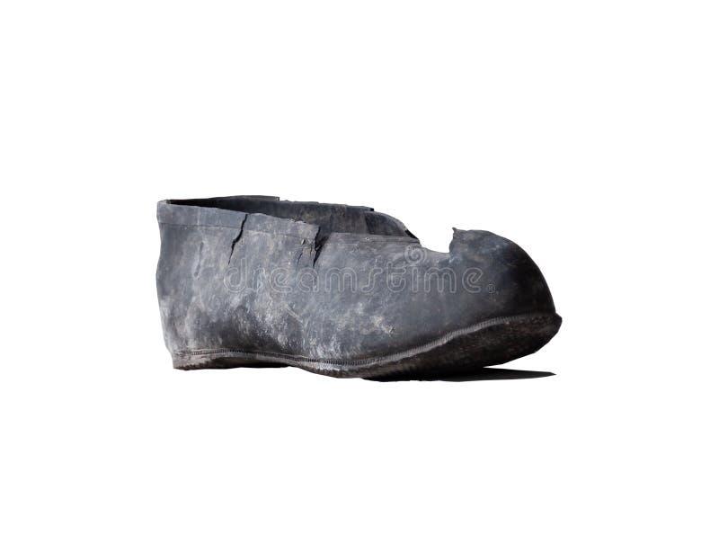 Singola scarpa residua nera di gomma isolata su bianco immagine stock