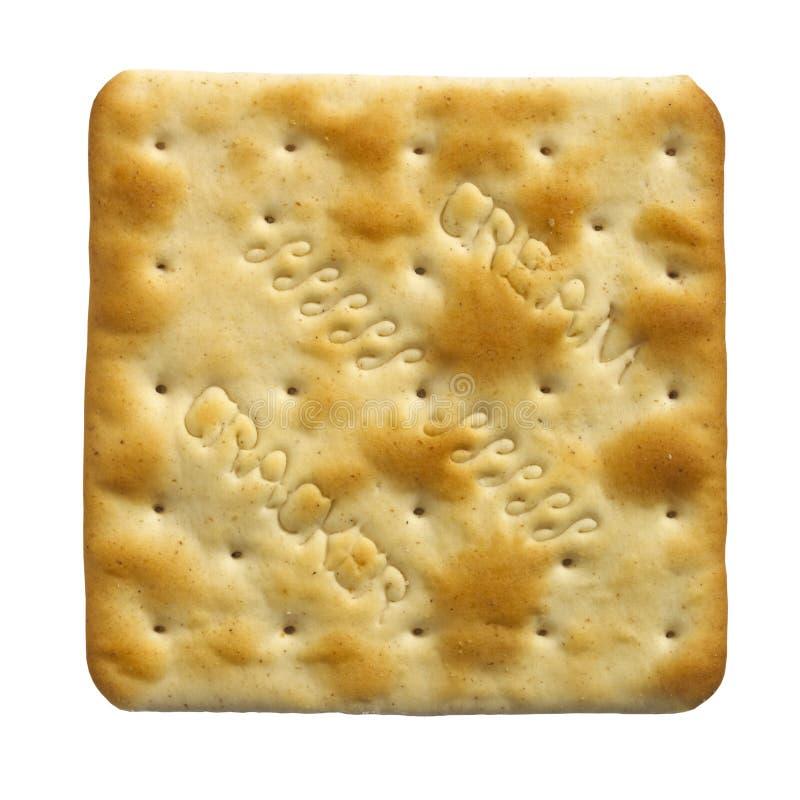 singolo biscotto crema del cracker su priorità bassa bianca fotografie stock