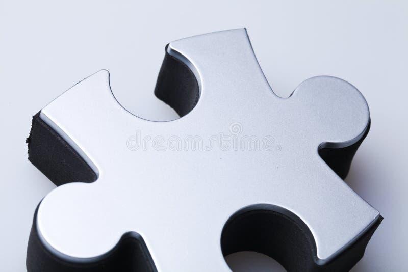 Singolo primo piano del pezzo di puzzle fotografie stock libere da diritti