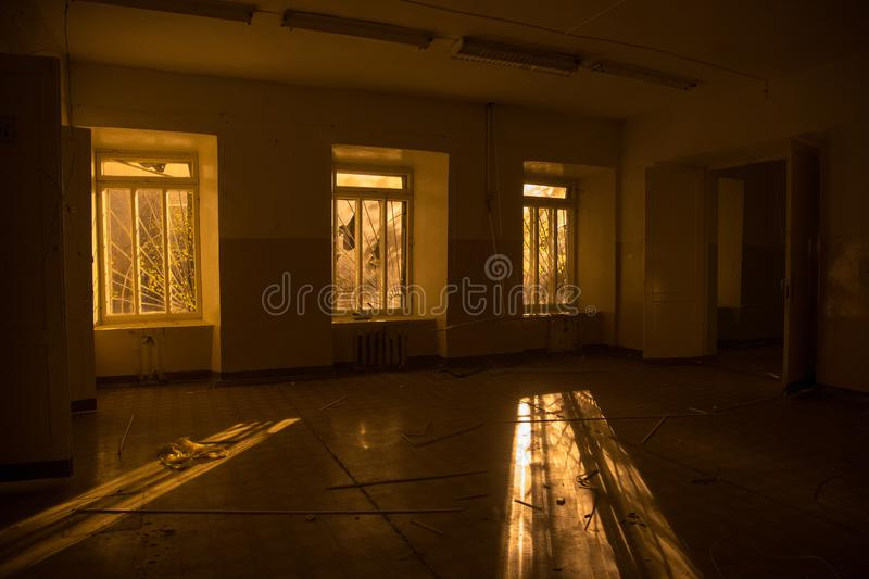 Sinister and creepy interior of abandoned and rotten hospital royalty free stock photo