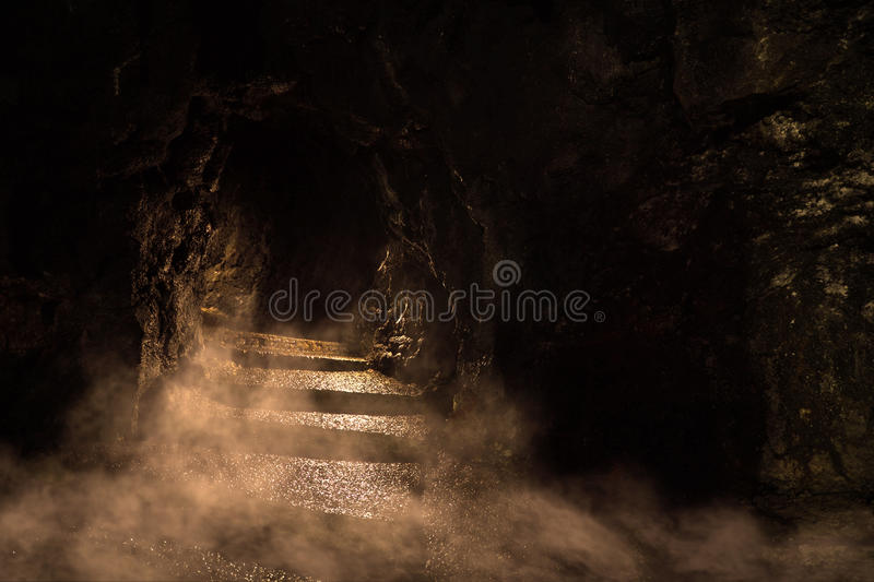 Sinister Dungeon. Ancient dark dungeon in the fog royalty free stock image