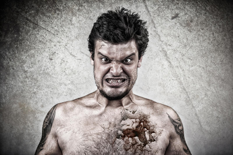 Sinister face with cracked skin, and ugly face. Sinister face with cracked skin royalty free stock images