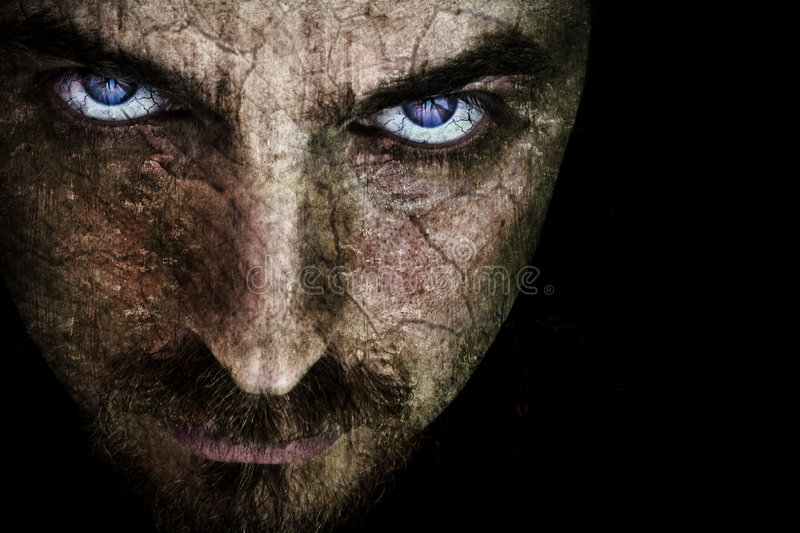 Sinister scary evil looking face. Close-up of sinister face, with cracked skin (fine details on eyes stock photo