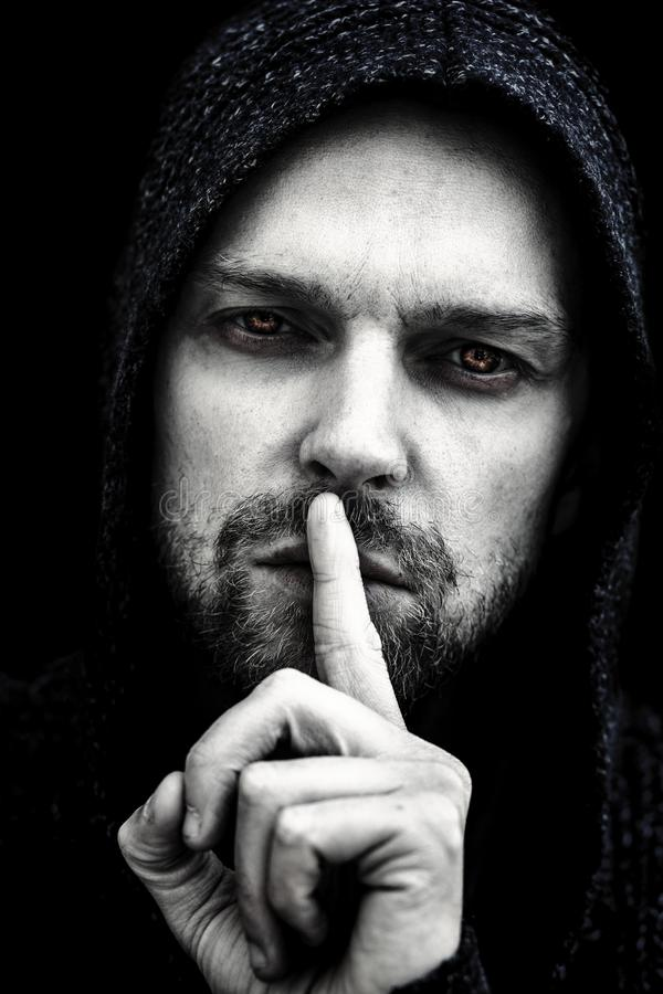 Sinister spooky man`s face in darkess royalty free stock images